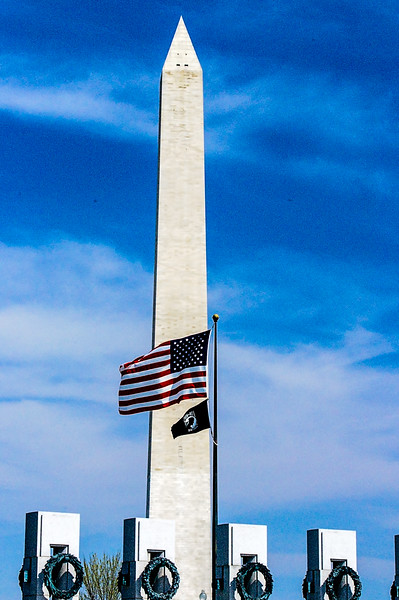 Washington Monument - Monument from the World War Two Memorial, with flag centered.