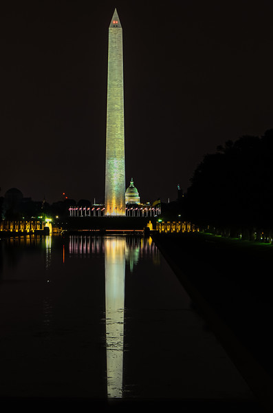 Washington Monument - View of the Monumentin at night with World War Two Memorial in the foreground and US Capitol in background.