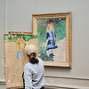 """The painting is """"A Girl with a Watering Can"""" by Renoir at the National Gallery of Art"""