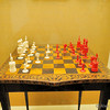 Table with inlaid chessboard and ivory chessmen from 1825, used by President John Quincy Adams.<br /> American History Museum