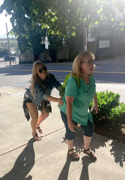 After 23 blocks of walking, Sharon discovers there is a hill to get to the Space Needle. Sarah does her best to move Sharon along.