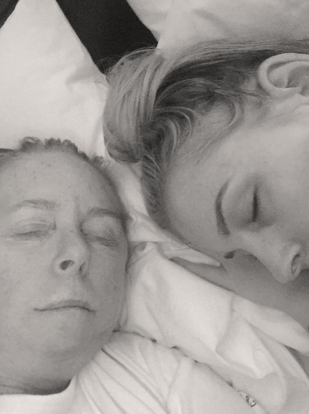 Mommy and daughter catching sleep.