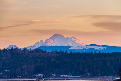 The first rays of light hitting Mt Baker