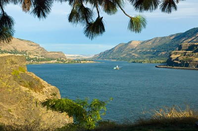 A tug boat plies the waters of the Columbia River
