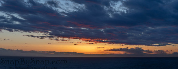 An evening cloudscape panorama with vivid colors in the sky