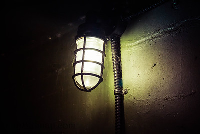 An old WWII era light illuminating the dark