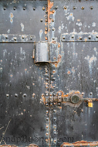 An old steel door showing the passage of time with its weathered look