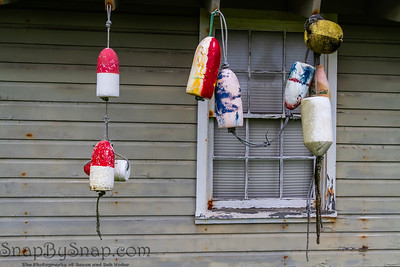 Fishing buoys hung in front of the windows