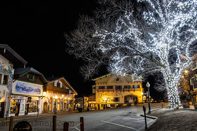 Bauernhaus style Bavarian buildings at night with Christmas lights