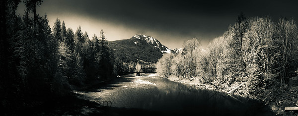 A dramatically lit black and white image of the South Fork Skykomish River