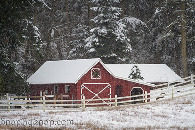 An old red barn in a winter wonderland