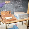 an original apple computer. it all began with a wooden box.