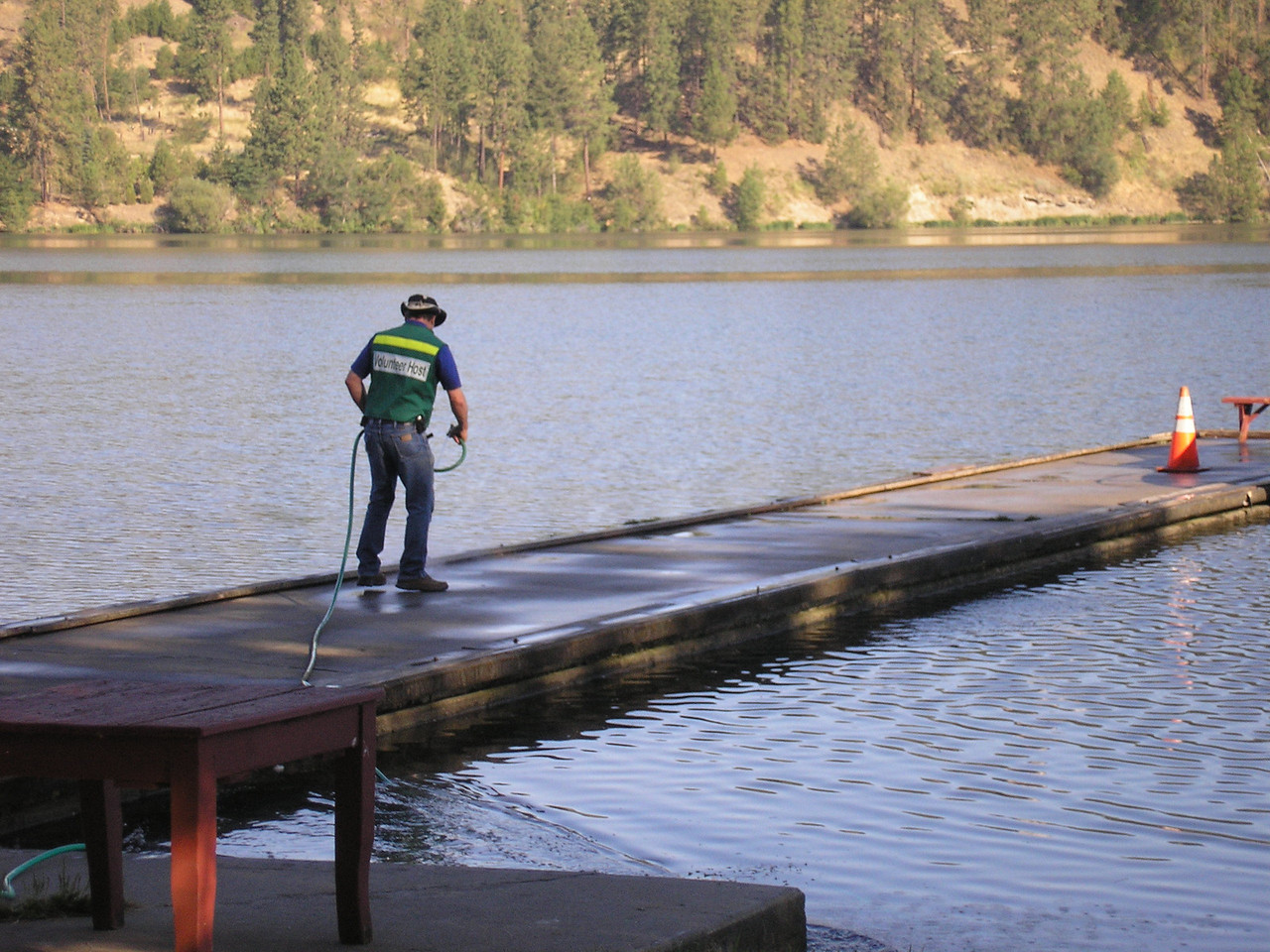 John on duty cleaning off the boat dock. The Ducks and Canadian Geese leave calling cards thet are messy.