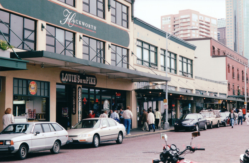 Pike Place Market Area - Seattle, WA  5-29-98<br /> A diverse marketplace that opened as a farmer's market in 1907.  The complex features produce, seafood, arts and crafts, street musicians, shops and restaurants.