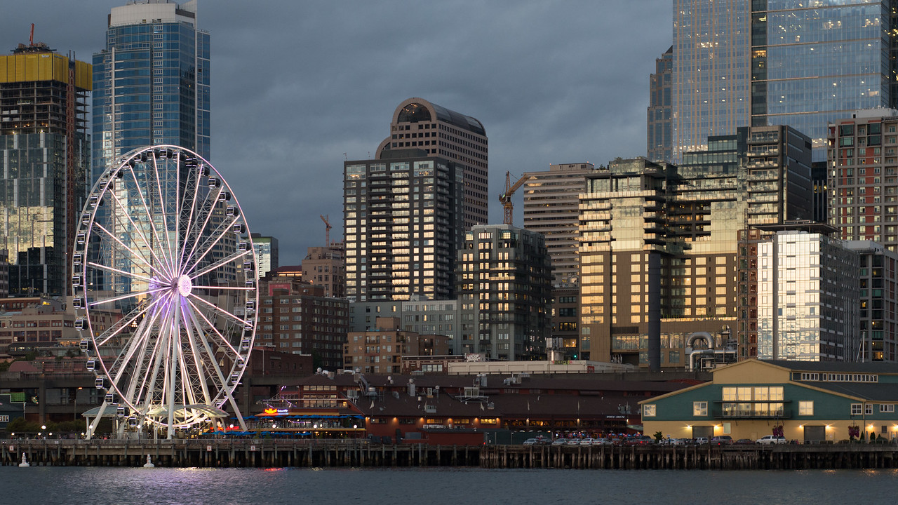 20160910.  Seattle skyline at sunset with waterfront Seattle Great Wheel, from ferry returning from Bainbridge Island, WA.