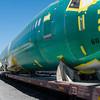 20160811. Airplane fuselage on train car.  Interbay train yard, Seattle Wa.