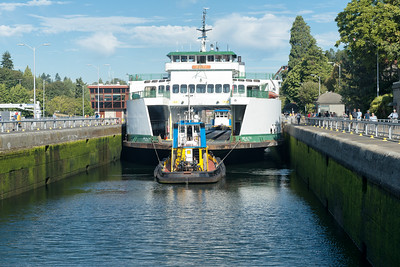 """20160725.  Ferry """"Sealth"""" being towed through Hiram M. Chittenden Locks in Ballard (Seattle WA).  It barely fits in the lock.  The Sealth is heading to a Lake Union drydock for maintenance."""