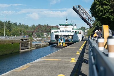 """20160725.  Ferry """"Sealth"""" being towed through Hiram M. Chittenden Locks in Ballard (Seattle WA).  The Sealth is heading to a Lake Union drydock for maintenance."""