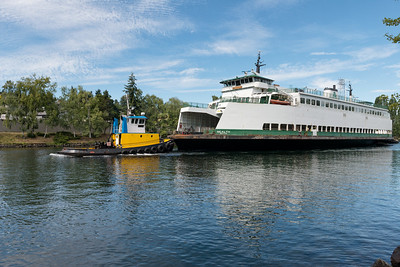 """20160725.  Ferry """"Sealth"""" being towed through Lake Washington Ship Canal.  The Sealth is heading to a Lake Union drydock for maintenance."""