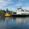 "20160725.  Ferry ""Sealth"" being towed through Lake Washington Ship Canal.  The Sealth is heading to a Lake Union drydock for maintenance."