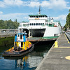 "20160725.  Ferry ""Sealth"" being towed through Hiram M. Chittenden Locks in Ballard (Seattle WA).  The Sealth is heading to a Lake Union drydock for maintenance."