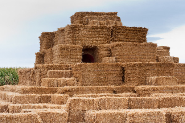 Pyramid of bales of hay for children's play area, Country Mercantile, Pasco, Washington.