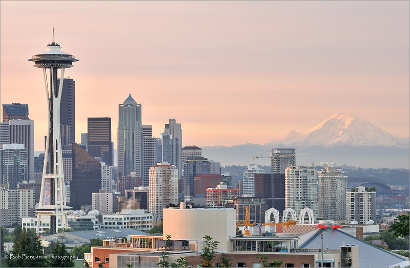 Seattle skyline and Space Needle in early morning light, with Mount Rainier in background