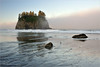 Sea stack and beach at sunrise, with fog, off the west coast of the Olympic Peninsula in Washington state.