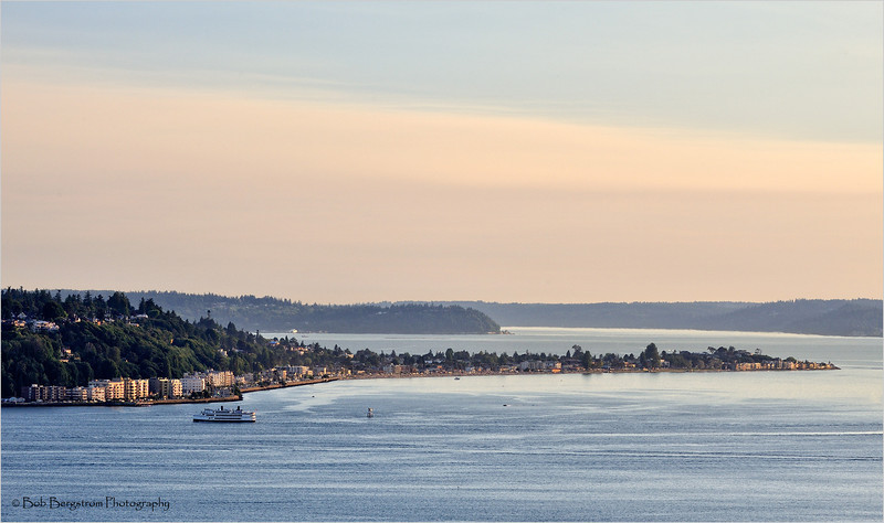 Puget Sound in the evening with a tour boat making it's way back into Seattle