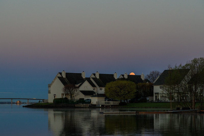 Moon setting up the Bay of Quinte just before sunset. Darker exposure.