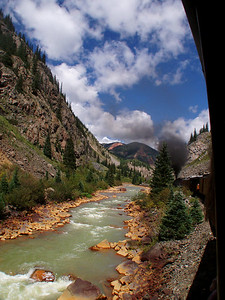 I've taken a few train rides on vacation, but this one was the best. The first few miles parallel the highway and you're thinking I could drive this myself. Then it heads into incredibly scenic areas that only the train goes. This was taken on the way into Silverton. Durango & Silverton Railroad