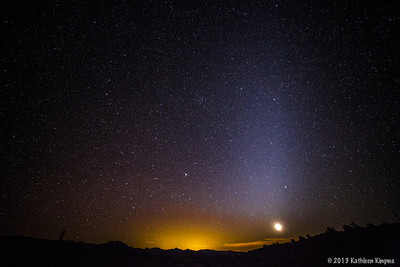 The rising moon and the Zodiacal lights before sunrise.