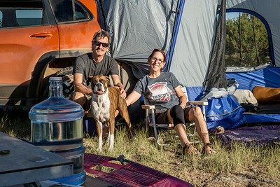 Steve, Bev, and Magoo relax after setting up camp.