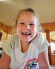 Coming into the weekend at camp Liliana had had a loose tooth for a while.  She pulled it out my first night at the camp and is showing off her gap here the next morning<br /> <br /> * Phone Picture