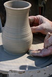Hands of a master...Robert Jones, potter, on the dock in Wiscasset.