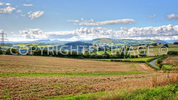View towards Skirrid Fawr and Sugarloaf with Edmund's Tump (right centre) from Pembridge Castle on the Broad Oak Rd