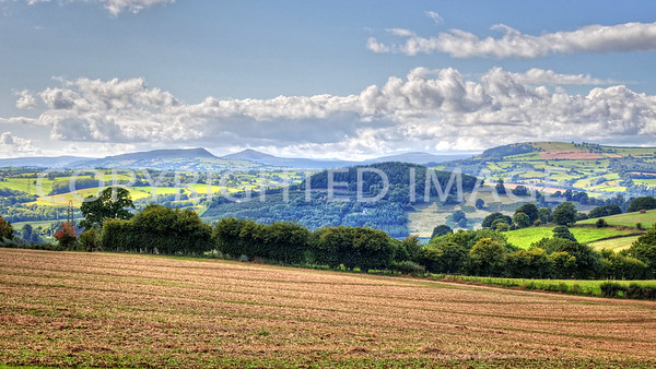 View towards Skirrid Fawr and Sugarloaf with Edmund's Tump (right) from Pembridge Castle on the Broad Oak Rd. Pen-y-Fan distant centre.