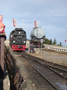 at the summit of the Brocken, performing a run-around for the return trip to Drei Annen Hohne. Note the narrow gauge transport trolley for standard gauge railcars.