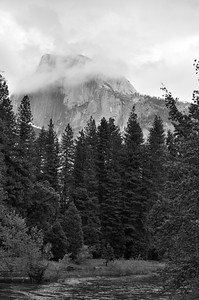 Half Dome, in Yosemite, through low lying clouds