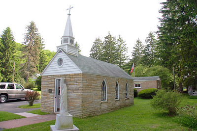 Our Lady of the Pines bills itself as the smallest Church in the 48 states. Located in Horse Shoe Run, WV.
