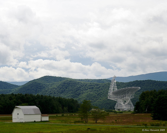 "The Robert C. Byrd Green Bank Telescope is the world's largest fully steerable radio telescope.  See <a href=""http://www.gb.nrao.edu/gbt/"">http://www.gb.nrao.edu/gbt/</a> for details about the telescope and the National Radio Astronomy Observatory where it is located.<br /> <br /> The NRAO is located in the middle of a large radio quiet zone, the National Radio Quiet Zone (NRQZ).  This zone was established in the 1950s when the NRAO was conceived.  The NRQZ permits the practice of radio astronomy without the interference of man-made radio signals.  Practically, for visitors to Pocahontas County, WV, this means that cell phones and AM/FM radios are useless.<br /> <br /> Several other devices are located at the NRAO.  One of the most interesting was the first parabolic radio telescope which was built by an amateur scientist, Grote Reber, in 1937.  The historic telescope is pictured in this gallery.<br /> <br /> This photo was taken from the closest point to the telescope that a visitor can use a camera since the electronic noise from the camera's operation could interfere with the recording of radio waves from outer space.<br /> <br /> Even in the NRQZ, malfunctioning appliances, e.g, microwave ovens, in the vicinity of the observatory can create noise in the observatory's recordings.  The NRAO has devices to locate these appliances and it works with the owners to correct the situation."