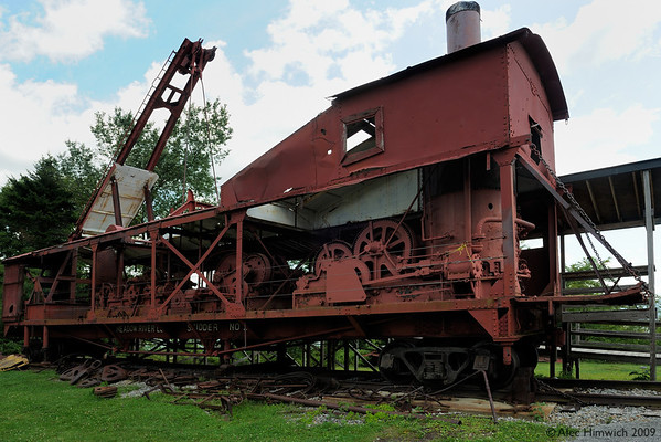 """This is a """"skidder"""" which was used to pull trees from the forest where they were cut.  By means of a pulley system, the cut trees are taken from the cutting site to a landing where they were loaded onto trains for transport to the sawmill.  <br /> <br /> Skidders could be powered by gasoline or steam and large one could retrieve logs from four different locations at a time.  See <a href=""""http://en.wikipedia.org/wiki/Skidder"""">http://en.wikipedia.org/wiki/Skidder</a> for more on skidder technology."""