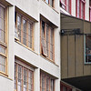 """<span id=""""title"""">Girl in Window</span> Colorful windows on the back of Pike Place Market."""