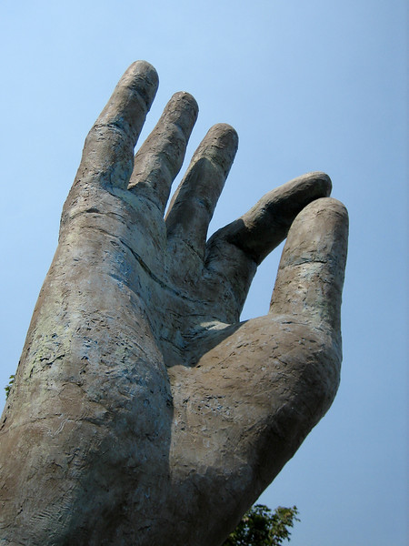 """<span id=""""title"""">Hand</span> Since our hotel was in downtown Portland, we set out walking on 8/4. This giant hand sculpture was in a car repair shop parking lot."""