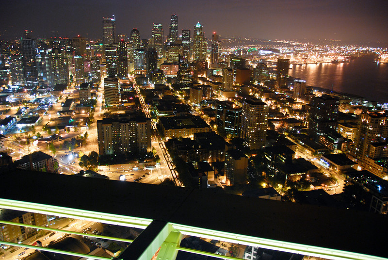 "<span id=""title"">Downtown Seattle</span> From the top of the Space Needle, or course. This is about 11:30pm - it closes at midnight. We bought day and night passes so we could come back the next morning and see everything in the daytime - I highly recommend it! I used one of anti-jumper cables to steady this otherwise handheld shot."
