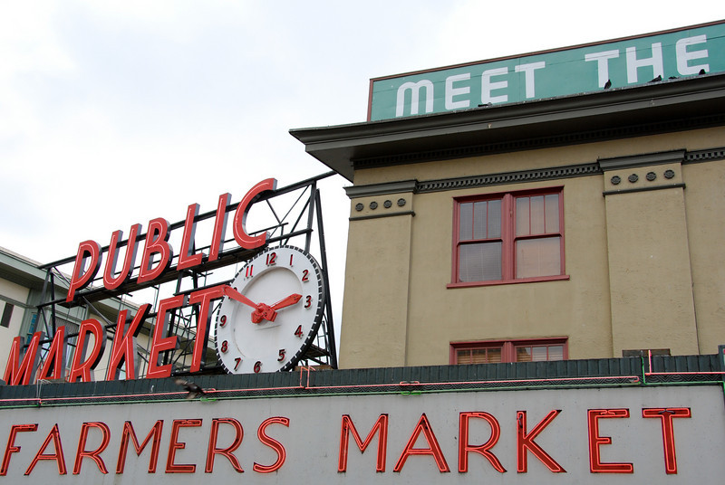 """<span id=""""title"""">Signs</span> Lots of signs at Pike Place Market"""