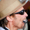 "<span id=""title"">Harmonica</span> There was a cool bluegrass-type band playing outside the original Starbucks. You can see the tents of the market reflected in his sunglasses. He was also playing a..."