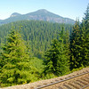 """<span id=""""title"""">Waiting, w/View</span> Most of 8/3 was spent on the train - takes about 18 hours to get from Oakland to Portland. Thanks to a broken down Union Pacific train, it was about 20 hours. At least we had a nice view while we were stopped. This is somewhere in Oregon..."""