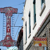 """<span id=""""title"""">Voodoo Doughnut</span> Awesome place. They're signature doughnut is shaped like a person, filled with red jelly and comes with pretzels stuck in it. Right next to a dilapidated theater that plays... well... not mainstream movies."""