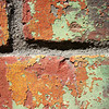 "<span id=""title"">Peeling Paint</span> Looks like this brick building used to be orange, and then green before that."